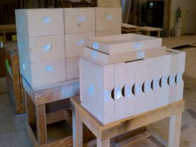 Dovetail drawer boxes labeled per product