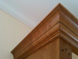 AWI Premium construction - Cabinet crown outside miters created prior to finish